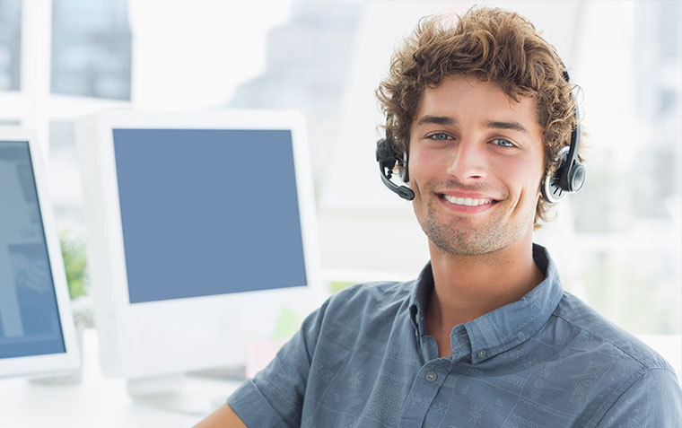 Smiling man with headset on